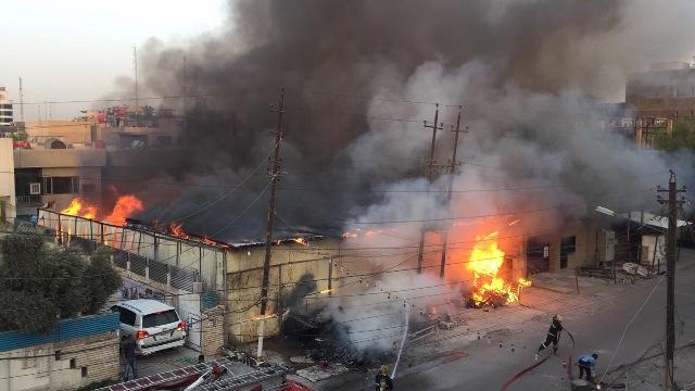 صور وفيديو حريق بالكرادة وسط بغداد