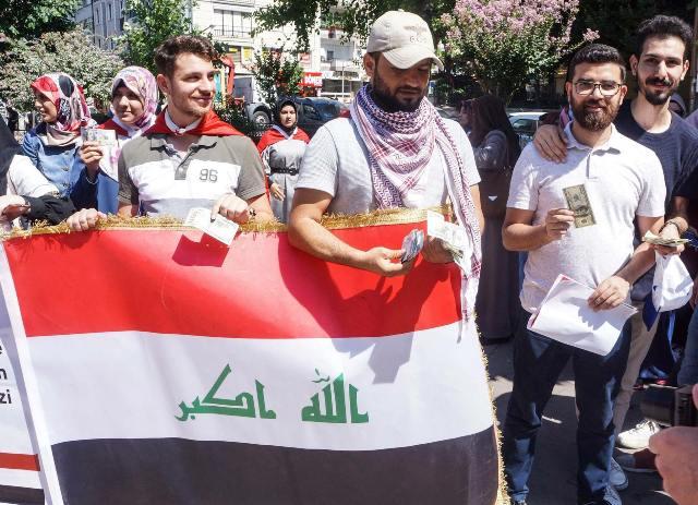 Iraqis support the Turkish lira 636699116668627749-39109153_1210892382393035_5847645222439223296_o