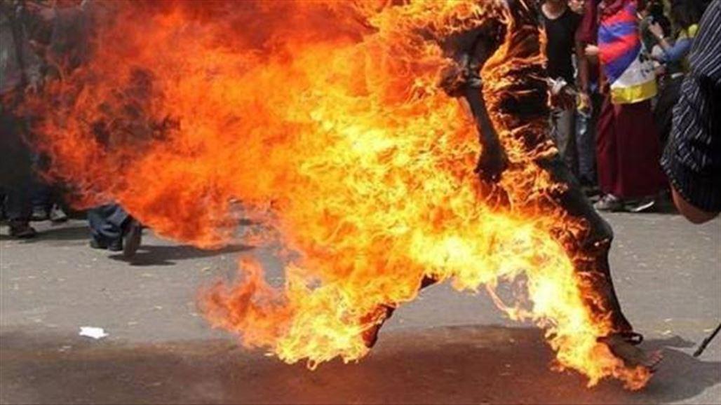 امام محكمة بغداد يحرق نفسه