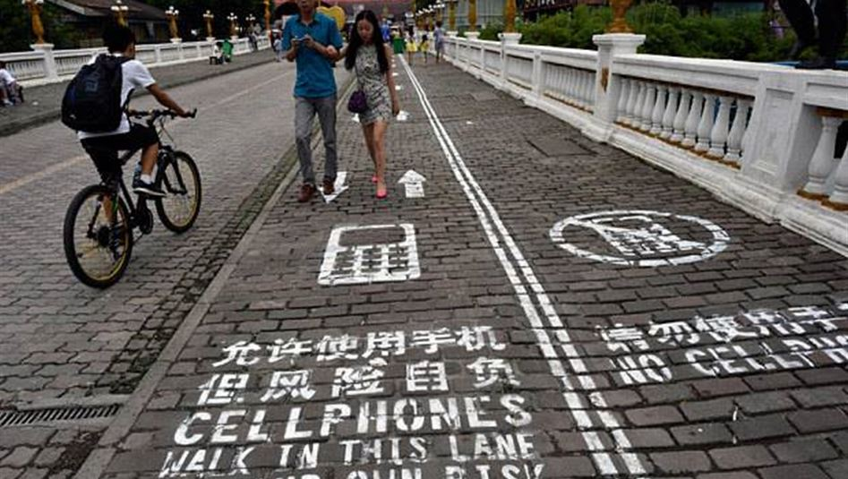 Chinese city paints street lane for mobile phone users