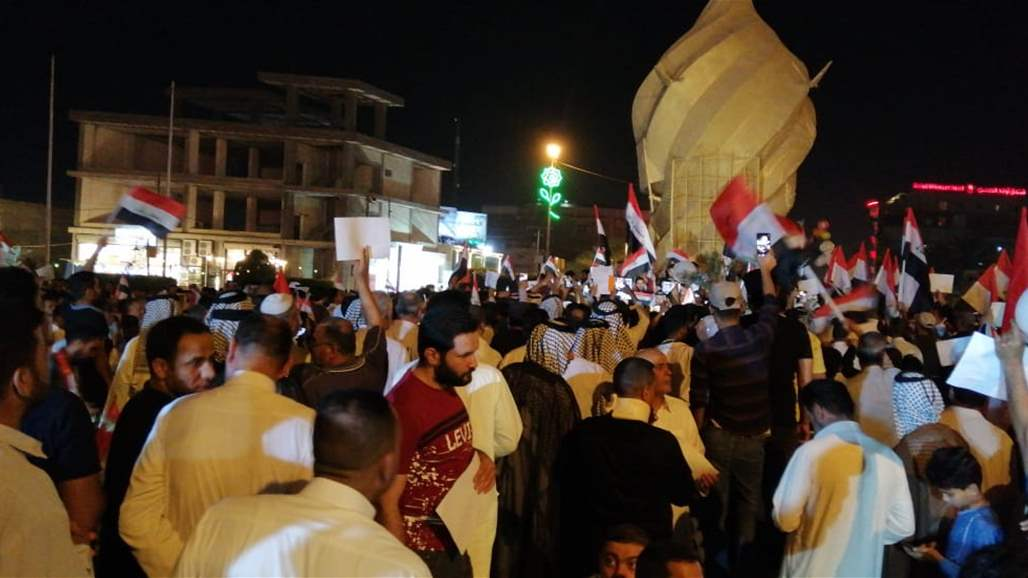 Hundreds demonstrate in the center of Karbala and demand the removal of the regional war on Iraq Doc-P-305468-636943192462046068