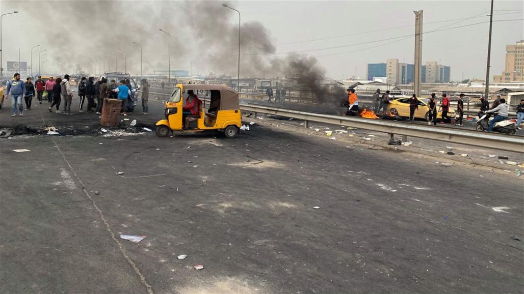 متظاهرون يعيدون غلق سريع محمد القاسم ببغداد